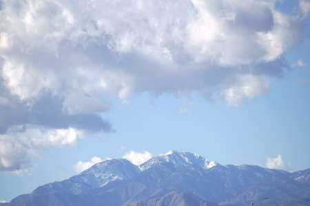 mountainscape: The snowcapped peak of Mount San Jacinto in the San Jacinto Mountains with clouds over the mountains.
