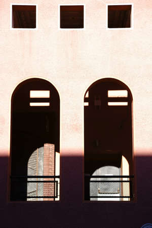 semicircle: An open window with a semi-circle and a railing. Stock Photo