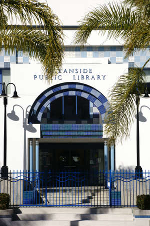 oceanside: Oceanside, United States - December 25, 2015: The entrance of the Oceanside Public Library decorated with colorful mosaic tiles and flanked by palm leaves on December 25, 2015 in Oceanside. Editorial
