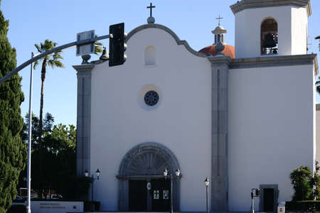 known: San Juan Capistrano, United States - December 25, 2015: The main entrance and a  bell tower of the well known spanish Mission Basilica San Juan Capistrano on 25 December 2015 in San Juan Capistrano.