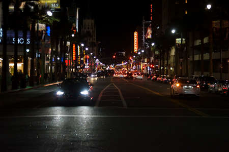 Hollywood boulevard: Los Angeles, United States - December 27, 2015: Traffic on the night-lit Hollywood Boulevard with shops and stores on December 27, 2015 in Los Angeles.