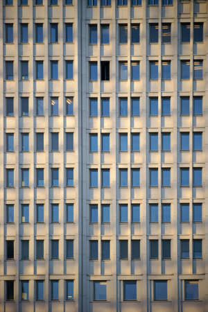 many windows: The facade of a modern office building with many windows.