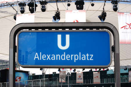 lighting system: Berlin, Germany - May 10, 2016: The blue sign of the underground station Berlin Alexander Place with a constructed stage tent in the background on May 10, 2015 in Berlin.