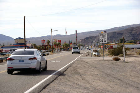 barstow: Barstow, United States - December 22, 2015: Traffic with cars on the main road with gas stations, shops and restaurants on December 22, 2015 in Barstow.