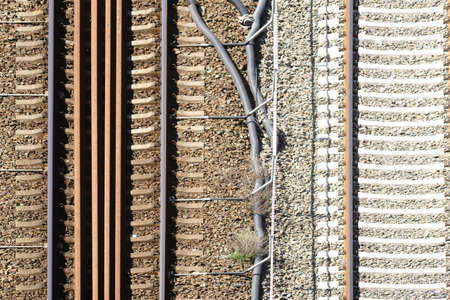 ballast: The plan view of a track bed with rails and ballast stones.