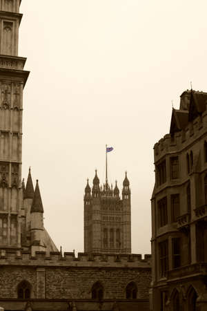 crown spire: London, UK - November 27, 2014: The British flag flies on a side tower with battlements, the Victoria Tower of Westminster Palace on November 27, 2014 in London.