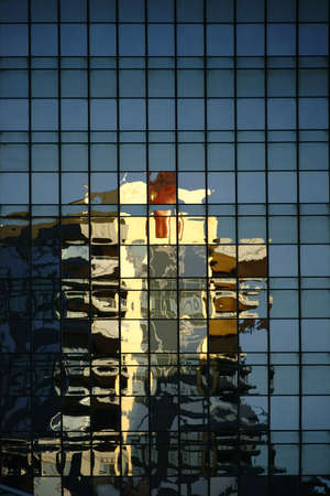 irregular shapes: Abstract Reflection of a residential building in the mirror windows of a skyscraper.