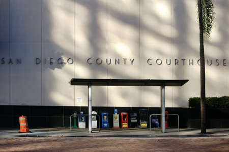 december 25: San Diego, United States - December 25, 2015: A bus stop with journal articles is on the facade of the courthouse on December 25, 2015 in San Diego. Editorial