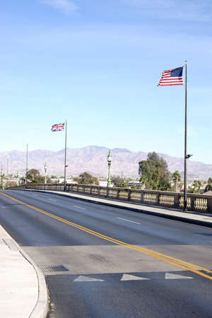 The replica of Robert P. McCulloch London Bridge in Lake Havasu City with waving British and American flags.