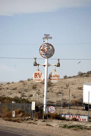 barstow: Barstow, United States - December 22, 2015: The Retro and Vintage sign of a sales shop for plumbing accessories in the desert on December 22, 2015 in Barstow.