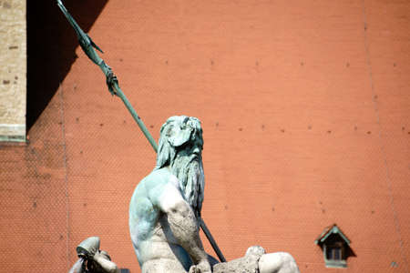 verdigris: Berlin, Germany - May 10, 2016: The closeup of the sculpture of Neptune from the famous Neptune Fountain on the Alexander Place on May 10, 2016 in Berlin.