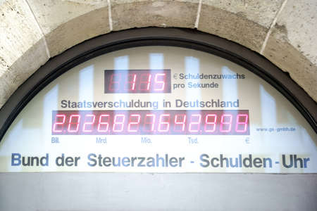 taxpayers: Berlin, Germany - May 10, 2016: The digital display and debt clock from Germany through the entrance of the office building of the German Taxpayers Federation on May 10, 2016 Berlin.