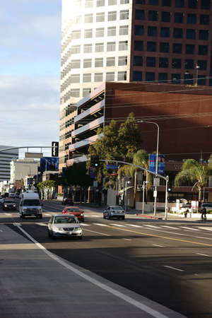 centers: Los Angeles, United States - December 27, 2015: The World Savings skyscraper, office buildings and shopping centers on the Wilshire Boulevard with traffic on December 27, 2015 in Los Angeles.
