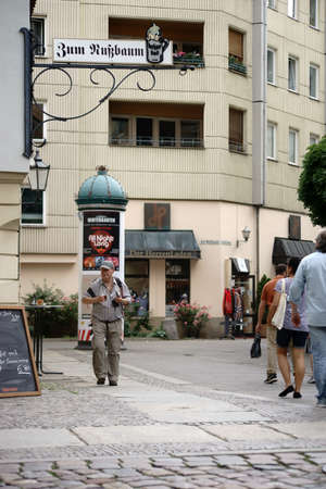 eating area: Berlin, Germany - June 21, 2016: Tourists visiting the oldest restaurant in Berlin, Zum Nussbaum in the Nikolai Quarter on June 21, 2016 in Berlin.