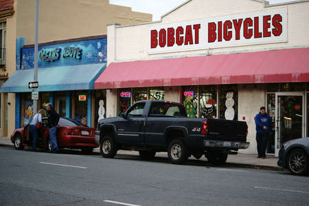 pet store: Salinas, United States - December 22, 2015: Cars parked in the Monterey commercial street in front of the bike shop Bobcat Bicycles and the pet store Oceans Above on December 22, 2015 in Salinas. Editorial