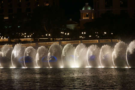 bellagio fountains: Las Vegas, USA - December 23, 2015: The famous fountain show in front of the Bellagio luxury hotel with water fountains and colorful lighting on Las Vegas Boulevard on the night of December 23, 2015 in Las Vegas. Editorial