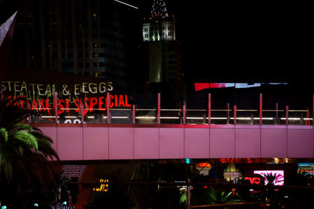 Las Vegas, USA - December 23, 2015: The abstract reflections of lights and advertising of Las Vegas Boulevard in the glass balustrade of a footbridge on December 23, 2015 in Las Vegas.