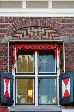 festively: A festively decorated window with nostalgic shutters and a Christmas star.