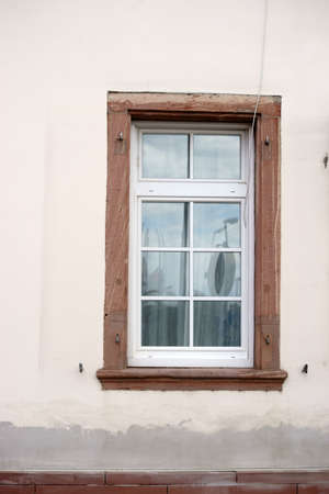 renovated: The nostalgic wooden windows of a listed house with a renovated facade.