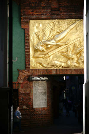 paula: Bremen, Germany - August 30, 2016: The famous Boettcher street in Bremen at the Paula Modersohn-Becker Museum with the gold relief Archangel Michael Fighting the Dragon on August 30, 2016 in Bremen.