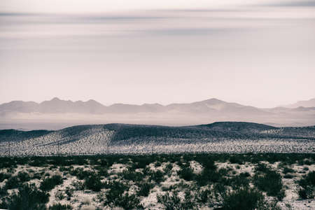 near death: Mountains and hills in the dry desert covered with dry grass near Death Valley Junction.