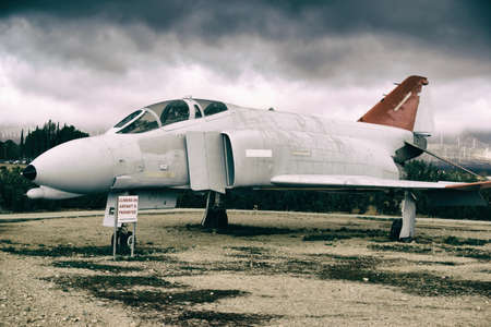 spaceport: Mojave, United States - December 22, 2015: A decommissioned fighter stands on a boneyard of the Mojave air and spaceport on December 22, 2015 in Mojave.