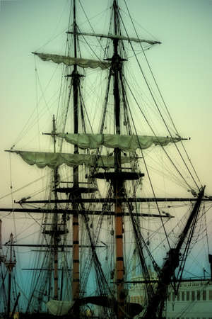 december sunrise: San Diego, United States - December 25, 2015: Old sailing ships of the Maritime Museum of San Diego anchored in the sunrise on December 25, 2015 in the port of San Diego.