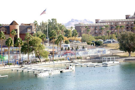 The shores of Lake Havasu with a boardwalk, city views and jetties in Lake Havasu City.