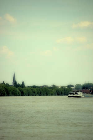 inland waterways: The stern of a container ship on the river Rhine near Mainz Kastel. Stock Photo