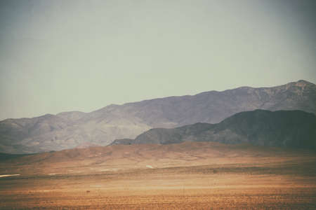near death: Top peaks and ranges of rough darker and brighter mountains in the Mojave Desert near Death Valley Junction.