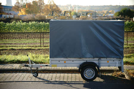 A car trailer for transporting small objects, tools and materials. Stock fotó - 65751540