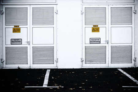 steel door: The striking side wall of a shopping center with a steel door to house technology.