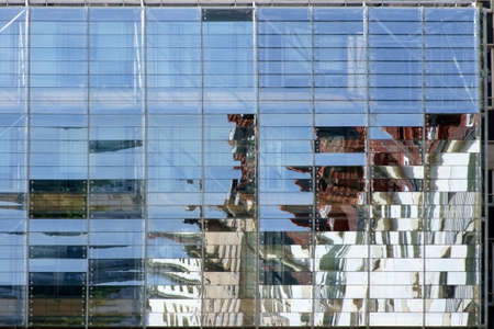 irregular shapes: The close-up of a facade of modern transparent plastic panels with abstract reflections.        Stock Photo