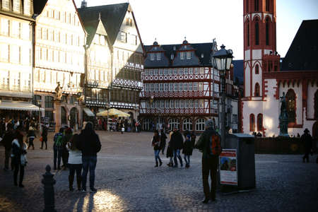 house gables: Frankfurt, Germany - January 05, 2017: Visitors and tourists are visiting the Roman Mountain with historic buildings and the Justice Fountain on January 05, 2017 in Frankfurt.