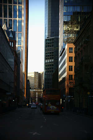 buss: Frankfurt, Germany - January 05, 2017: Road traffic between banking buildings and high-rise buildings in the banking district on January 5, 2017 in Frankfurt.