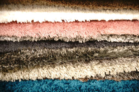 floor coverings: The close-up of fabric fluff and floor coverings of stacked carpets.