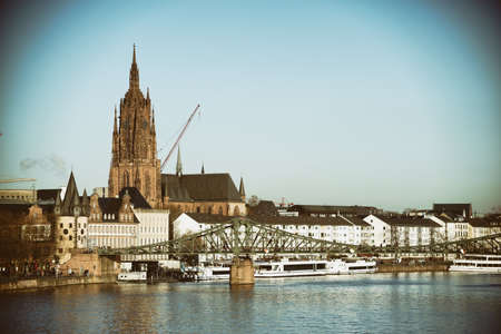 hessen: The bridge Ironbridge and the Tower of Frankfurt Cathedral and other historic buildings of the Old Town in Frankfurt. Stock Photo