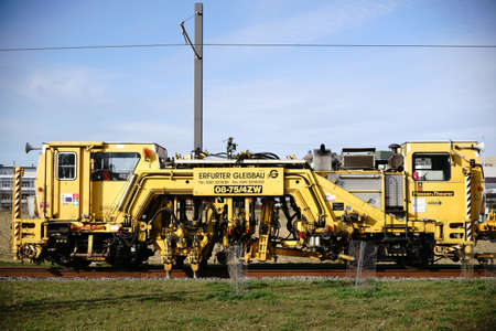 Mainz, Germany - March 09, 2017: The tamping and straightening machine 08-75  4ZW Plasser & Theurer in track construction on March 09, 2017 in Mainz.