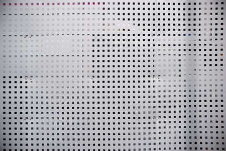 gratings: A sheet metal grid with square holes for separation, privacy and visual protection.