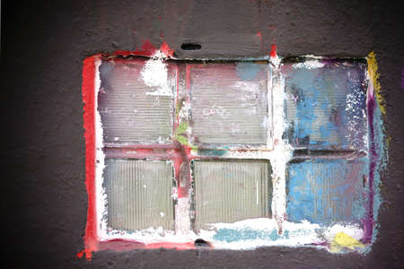 daubs: The closeup of a colorful painted window with glass tiles.