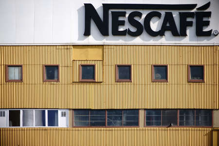 building sector: Mainz, Germany - March 24, 2014: The facade of the industrial building of the beverage and coffee maker Nescafe with logo on March 24, 2017 in Mainz. Editorial