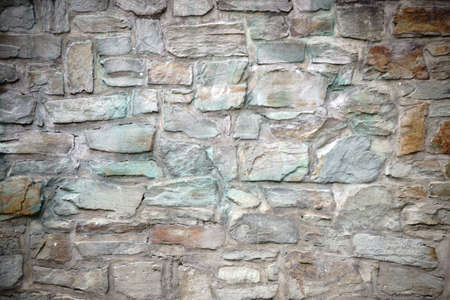 verdigris: A striking wall with differently colored and corrosive stones. Stock Photo