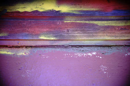 daubs: The closeup of the facade of a building with a colorful painted wooden strip.