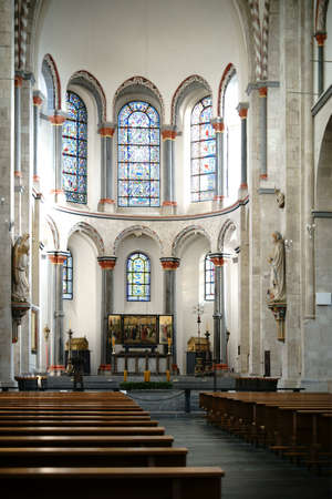 Cologne, Germany - November 24, 2016: The interior of the St. Kunibert church with the altar, religious relics and a triptych on November 24, 2016 in Cologne. Editorial