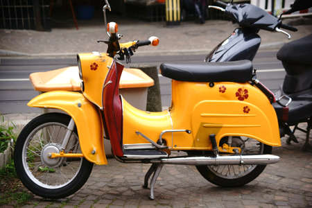The side view of an old nostalgic motorcycle, a moped brand swallow.