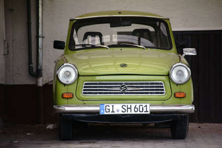 Giessen, Germany - September 30, 2017: The front view of an old vintage car from the trabant in a parking lot on September 30, 2017 in Giessen. Editorial