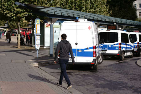 squad: Mainz, Germany - October 03, 2017: Police car at a bus stop station on the day of German Unity on October 03, 2017 in Mainz.