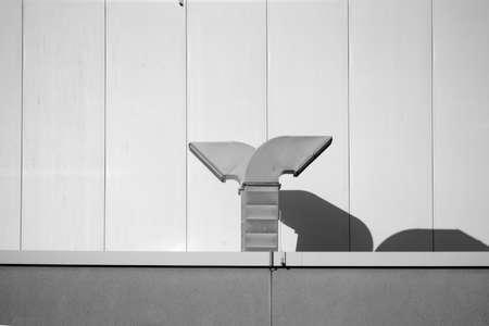 Extractor hoods on the false ceiling of a modern building cast shadows.                         版權商用圖片