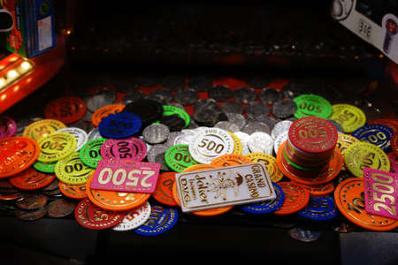 Berlin, Germany - December 05, 2017: The close-up of Casino Ships as well as coins in a slot machine at a Christmas market on December 05, 2017 in Berlin.