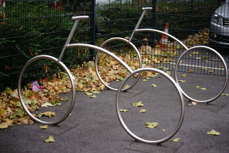 Abstract stainless steel bicycle racks in the shape of a racing bike.